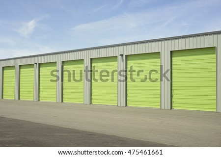 Green and gray outdoor storage units.