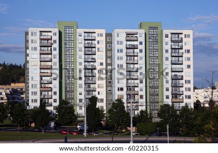 Green and grey prefab house with many balcons and windows - stock photo