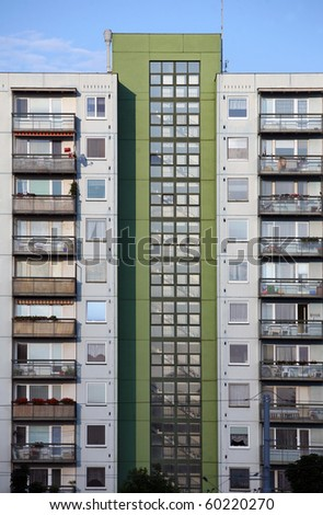 Green and grey prefab house with many balcony and windows - stock photo
