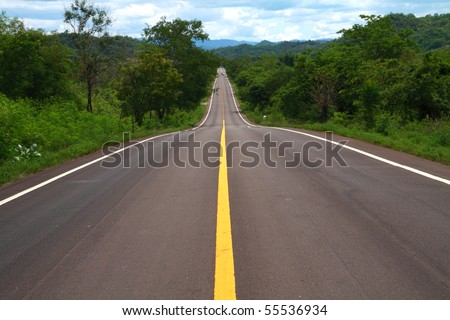 green and long hilly road, Thailand. - stock photo