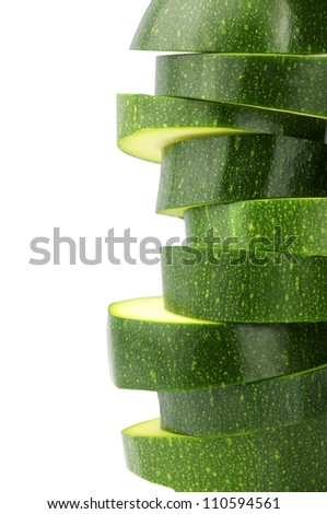 Green and natural slices of zucchini on white background - stock photo