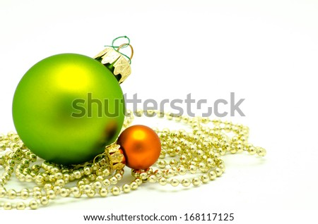 Green and orange cristmas bauble - stock photo