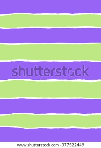 Green and purple wrapping paper torn into strips