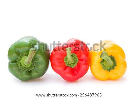 green and red and yellow bell peppers on a white background