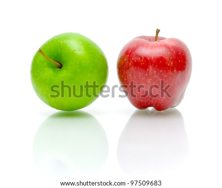 Green and red apple on a white background with reflection closeup - stock photo