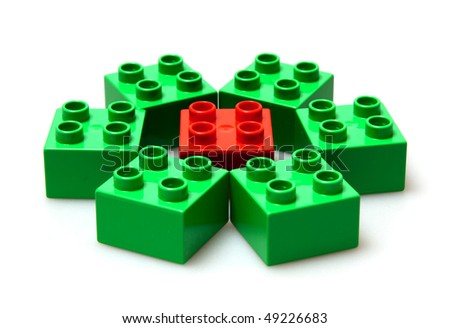green and red bricks on white - stock photo
