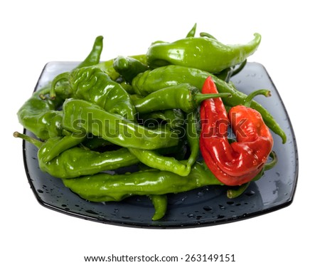 Green and red chili peppers on glass plate. Isolated on white background. - stock photo