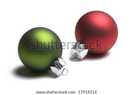 Green and red Christmas ornaments isolated on white background