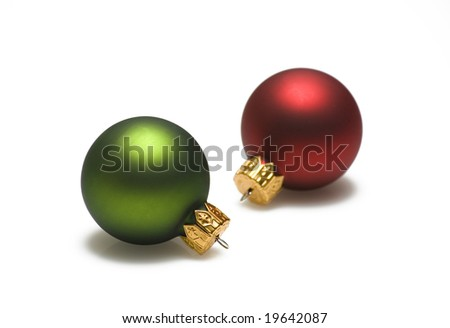 Green and red christmas ornaments on white background