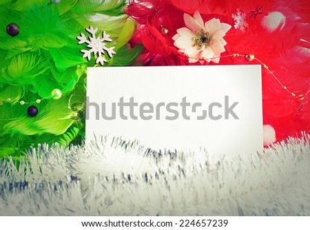 green and red christmas tree made of feathers with greeting cards - stock photo