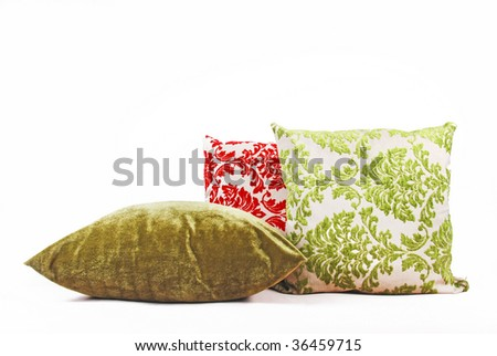 Green and red cushions against a white background - not isolated - stock photo