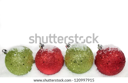 Green and red ornaments on a white background - stock photo