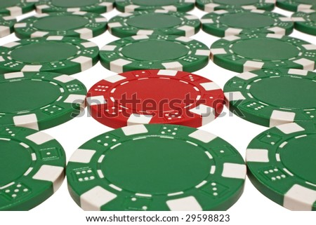 Green and red poker chips isolated on white background