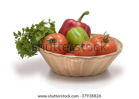 Green and red stuff. Fresh vegetables. Diet concept. Basket of woven twigs - stock photo