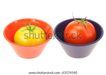 green and red tomatoes in a bowl isolated on white
