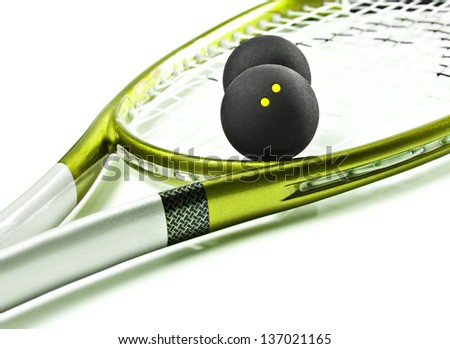 Green and silver squash racket and balls - stock photo