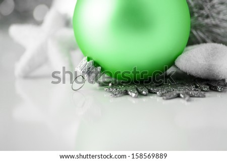Green and silver xmas decoration on white background with copy space - stock photo