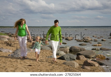 Green and whie family on the beach