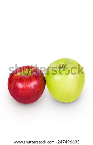 Green and white apples side by side on a white background