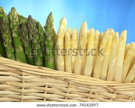Green and white asparagus in basket - stock photo