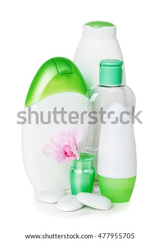 Green and white containers with different cosmetics, isolated on white background