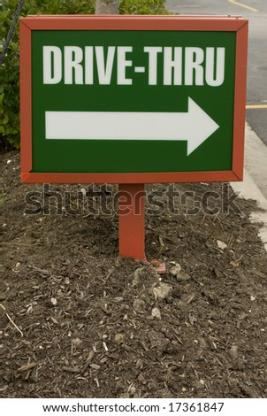 Green and white plastic drive-thru sign in the ground - stock photo