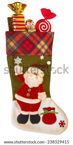 Green and white stocking with candies isolated on white background