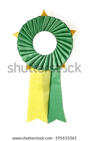 green and yellow award rosette on a white background - stock photo