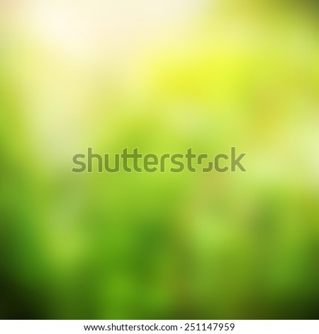 Green and yellow blurred abstract background with magic lights - stock photo