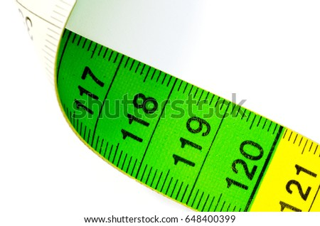 green and yellow cloth tape measure with the numbers 117 to 121 on white background