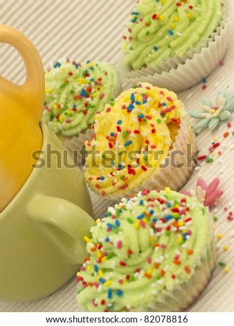 green and yellow cupcakes - stock photo