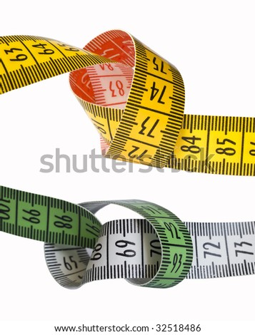 green and yellow curved measuring tapes - stock photo