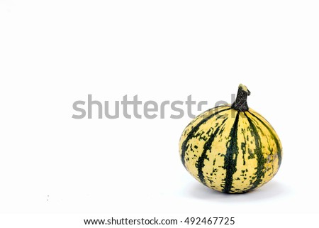 Green and yellow pumpkin isolated on white