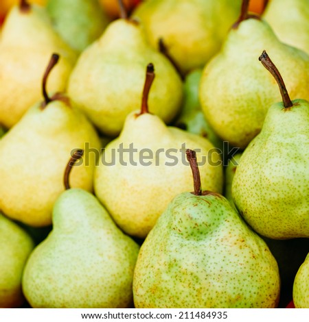 Green And Yellow Ripe Pears At A Farmers Market. Fruits Background - stock photo