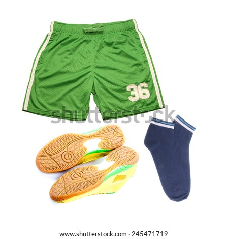 Green and yellow Sport clothes, shoes green shorts blue socks  sneakers isolated on white  background. - stock photo