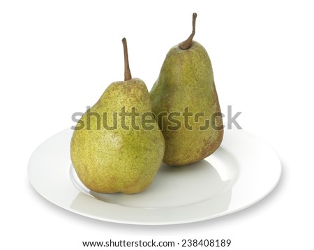 Green anjou pear on a white plate with clipping path