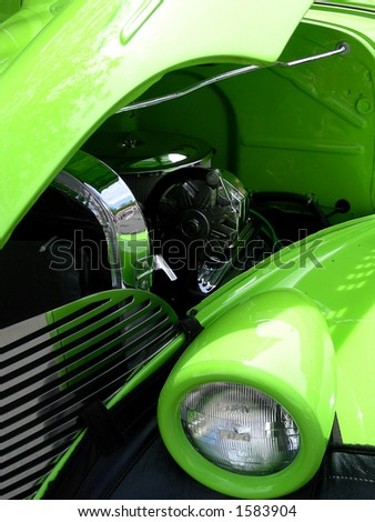 Green 1939 antique car, head lamp, grill and engine