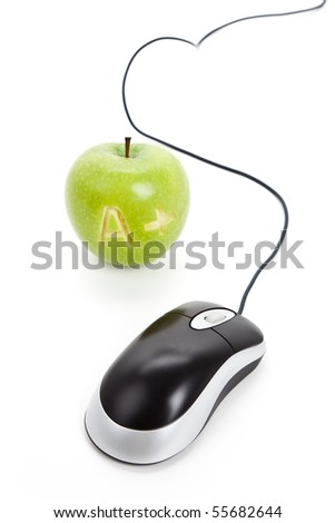 Green apple and computer mouse close up - stock photo