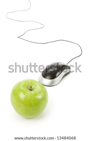 green apple and computer mouse, concept of online learning