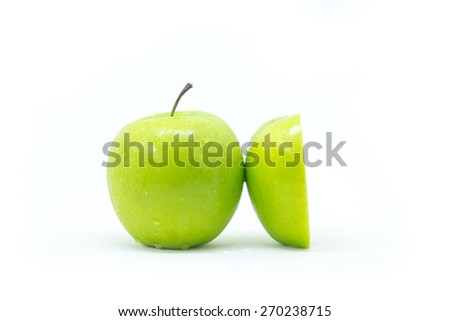 Green apple and Green apple sliced in half on white background - stock photo