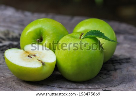 Green apple and half with seeds Green apple. - stock photo