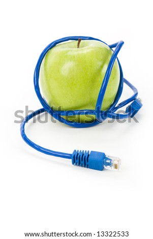 Green apple and Network cable, Danger of internet - stock photo