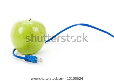 Green apple and Network cable, online learning - stock photo