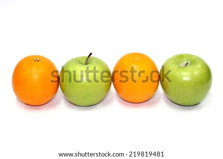 green apple and orange, isolated  - stock photo