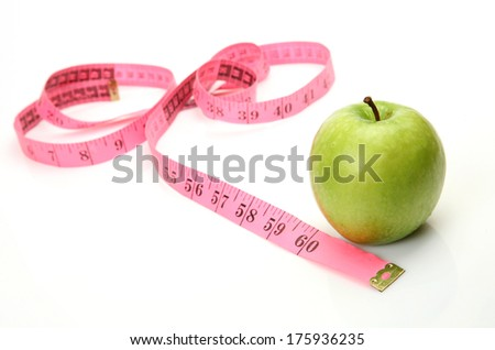 Green apple and pink tape
