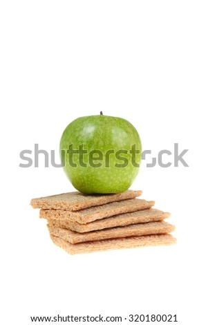 Green apple and rye bread isolated on white background - stock photo