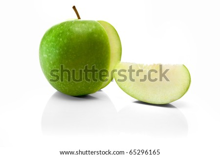green apple and slice isolated over a white background - stock photo
