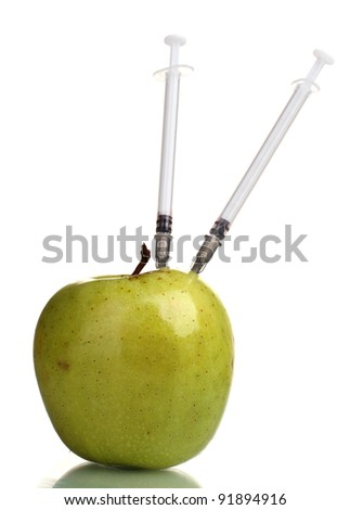 green apple and syringes isolated on white - stock photo