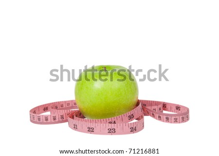 Green apple and tape isolated on white background