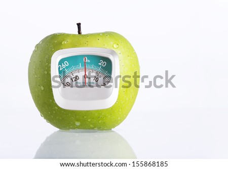 Green Apple and weight measurement meter-diet concept - stock photo